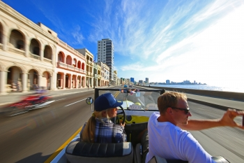 IMG_3761-Cruising-down-Havana-waterfront-in-a-classic-restored-Ford-convertible